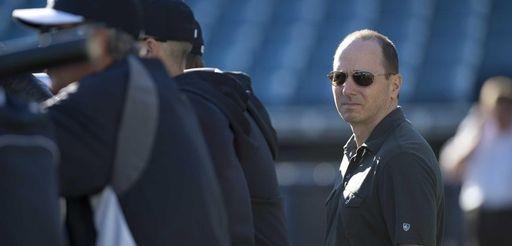 Brian Cashman watches batting practice at Steinbrenner Field