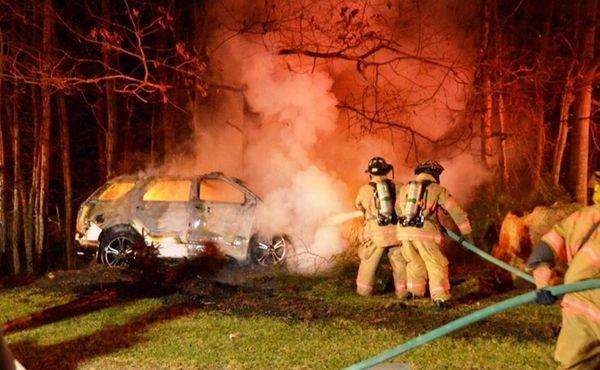 Manorville Fire Department personnel battle a car fire