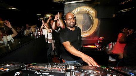 DJ Frankie Knuckles plays at the Def Mix
