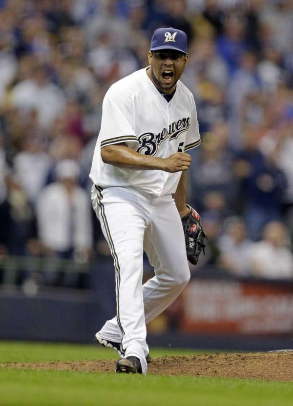 Milwaukee Brewers pitcher Francisco Rodriguez reacts after getting