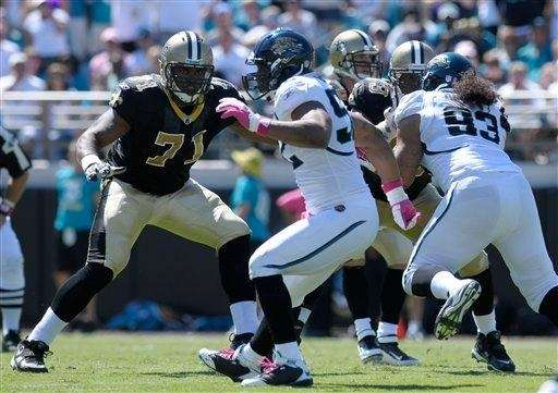 New Orleans Saints offensive tackle Charles Brown, left,