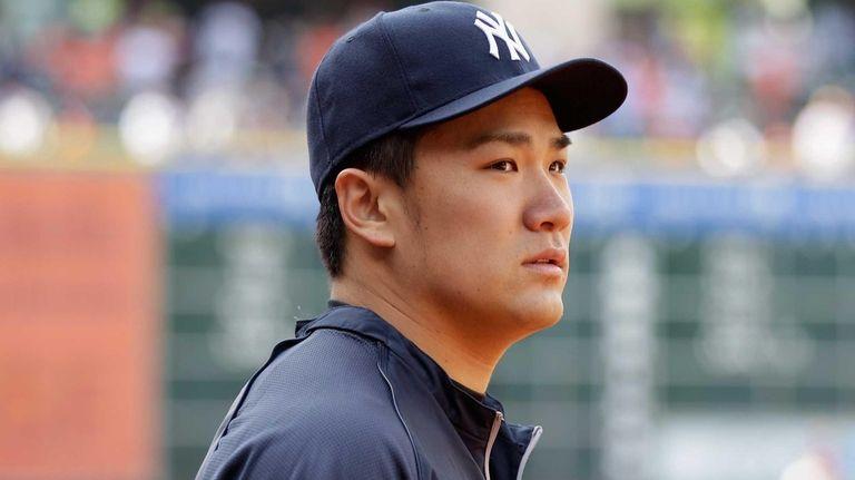Masahiro Tanaka looks on during batting practice before