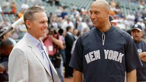 Derek Jeter, right, talks with former Houston Astros