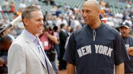 Derek Jeter, right, talks with former Houston Astros