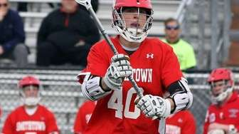 Smithtown East's Brian Willetts keeps control during the