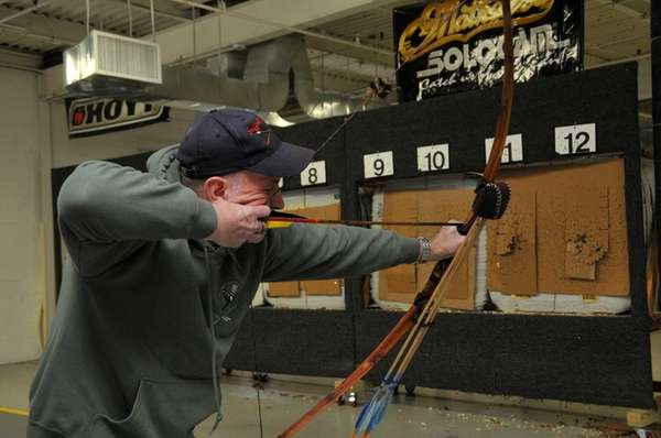 John Hargreaves, an archer from Farmingville, practices his