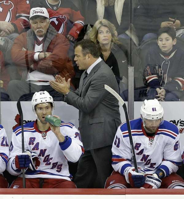 Alain Vigneault shouts to his players on the