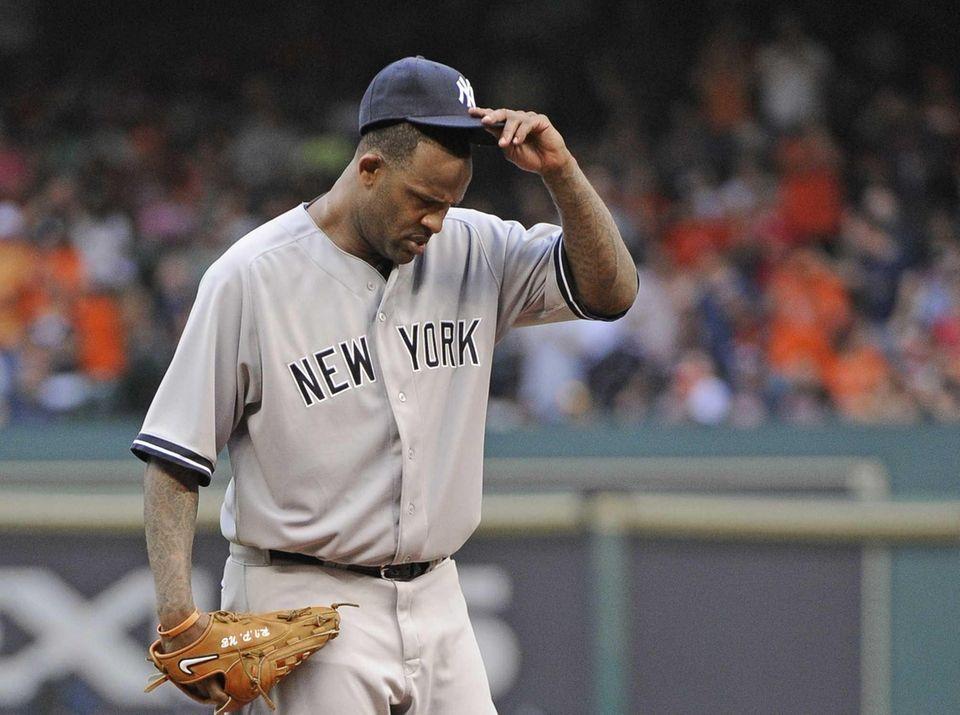 Yankees starting pitcher CC Sabathia adjusts his cap