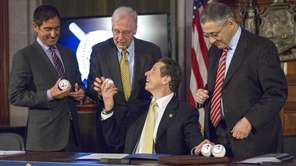 Gov. Andrew M. Cuomo celebrates the signing of