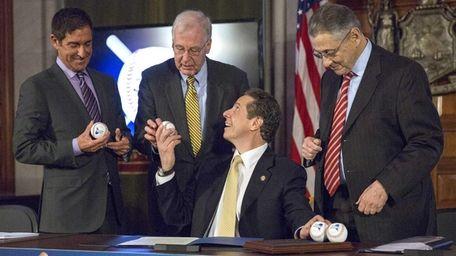 Gov. Andrew M. Cuomo celebrates the signing of