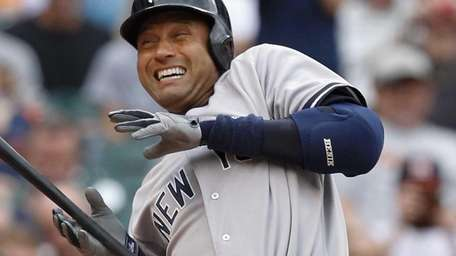 Derek Jeter of the Yankees is hit by