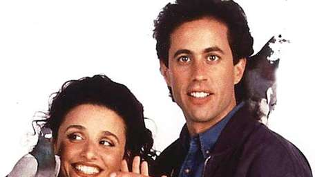 Julia Louis-Dreyfus as Elaine Benes and Jerry Seinfeld