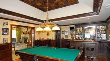 The pub room in this Dix Hills house