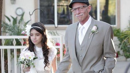Terminally ill father Jim Zetz walks his 11-year-old
