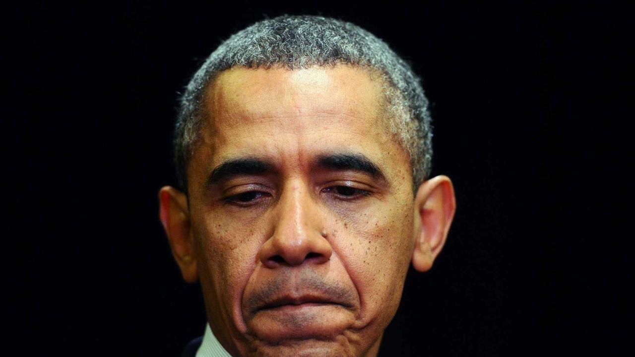 U.S. President Barack Obama pauses as he makes