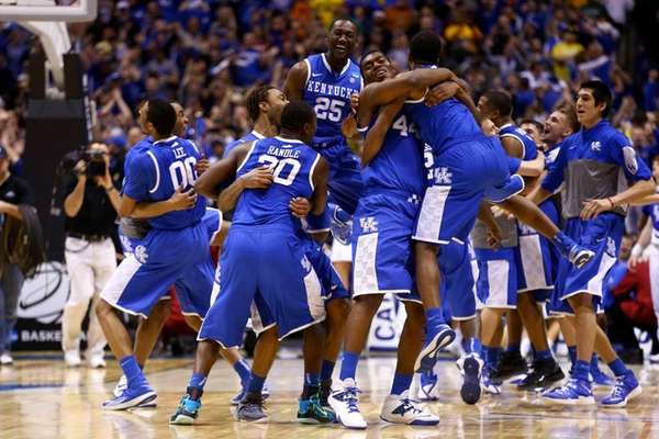 Aaron Harrison #2 of the Kentucky Wildcats celebrates