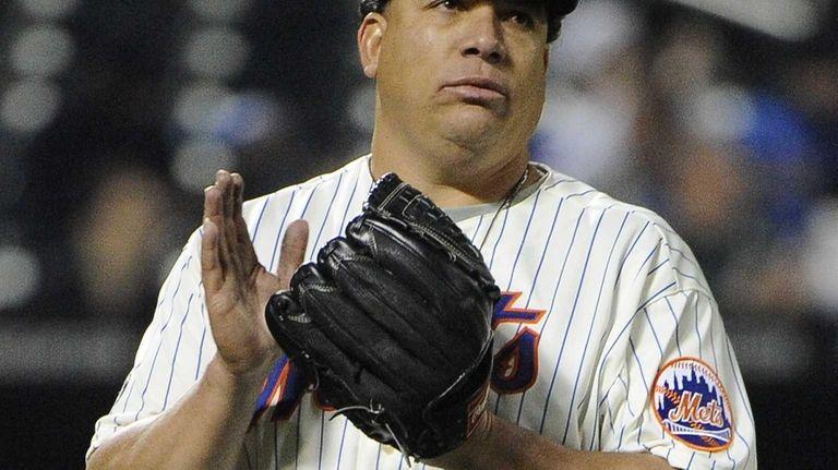 Mets pitcher Bartolo Colon reacts as he walks