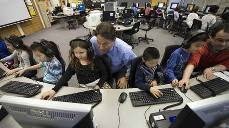 Jericho Public School Superintendent Henry Grishman interacts with