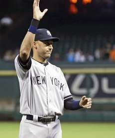 Derek Jeter waves to the crowd during a