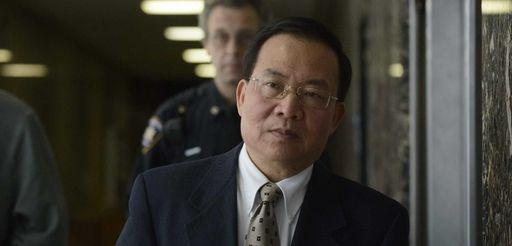 Dr. Stan Xuhui Li walks in the hallway