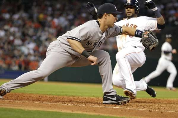 Yankees first baseman Mark Teixeira doubles off Houston
