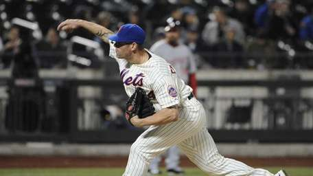 Mets pitcher Kyle Farnsworth delivers against the Washington