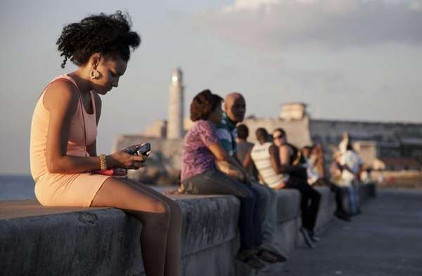 A woman uses her cellphone as she sits
