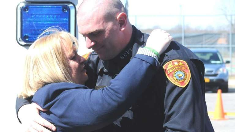 Suffolk County police officer Matthew Siesto greets Teri