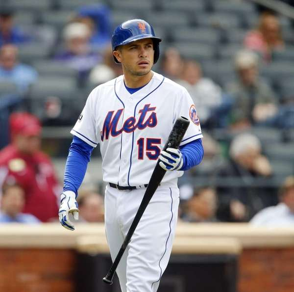 Travis d'Arnaud walks back the dugout after striking