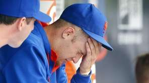 Zack Wheeler sits in the dugout after the