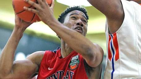 Findlay Prep.'s Craig Victor fights inside during the