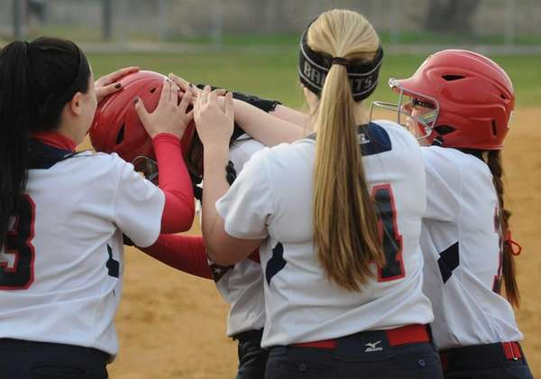 MacArthur catcher Kristen Arbiter get congratulated by teammates