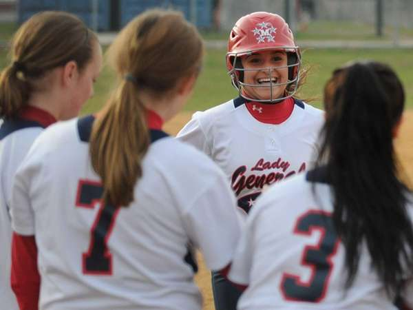 MacArthur catcher Kristen Arbiter is greeted by teammates