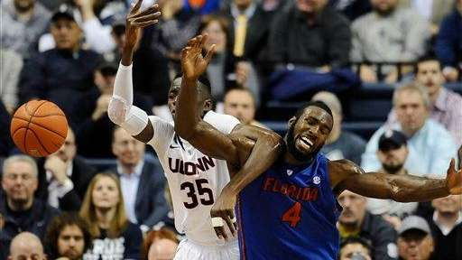 Connecticut's Amida Brimah and Florida's Patric Young, right,