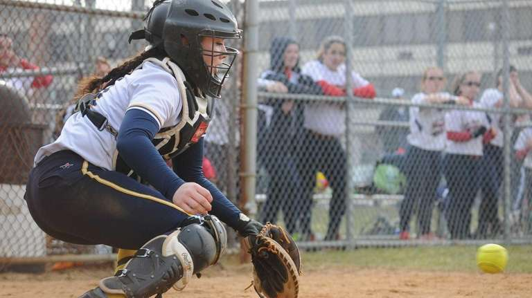Massapequa catcher Darby Pandolfo blocks a low pitch