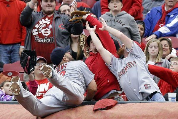 St. Louis Cardinals first baseman Matt Adams falls