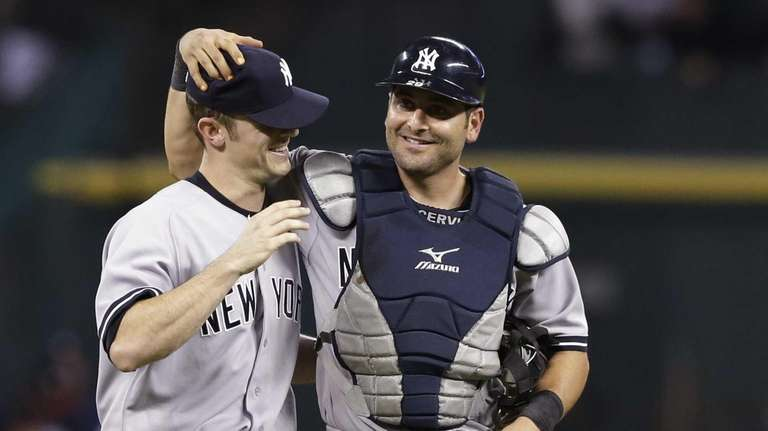 Yankees catcher Francisco Cervelli, right, messes with closing