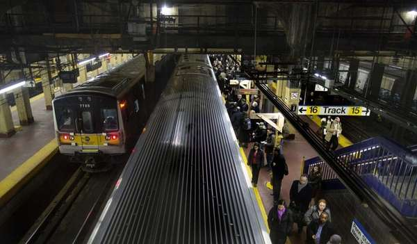 Commuters wait for trains during the afternoon rush