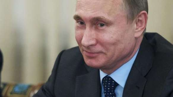 Russian President Vladimir Putin listens to the CEO