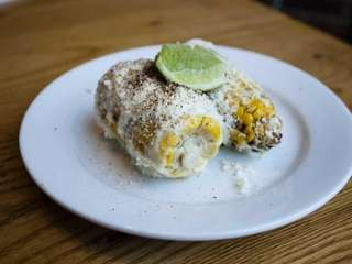 "The grilled ""street"" corn-on-the-cob, with a creamy cojita"
