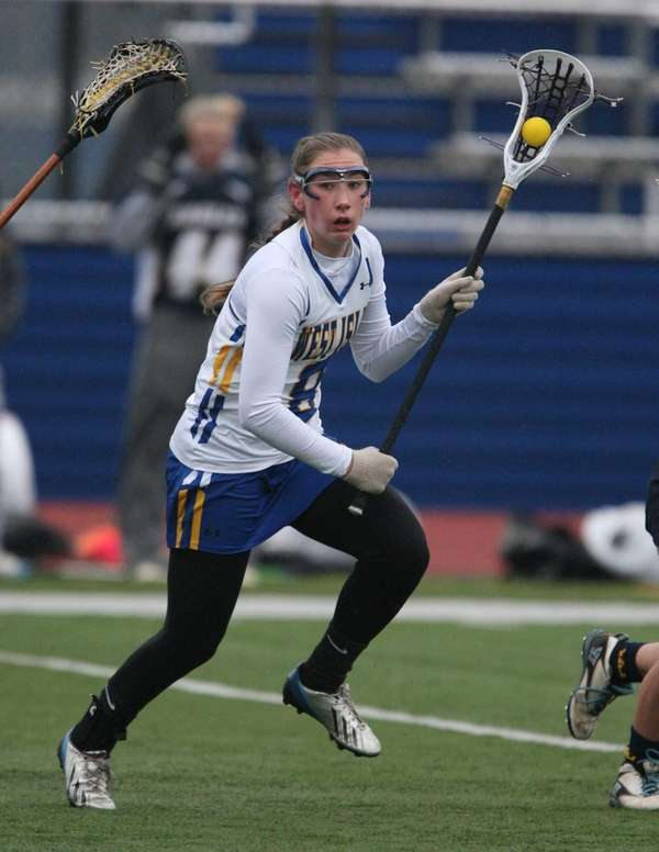 West Islip's Lindsay Darrell moves the ball on