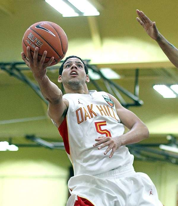 Oak Hill Academy's Cody Martin gets the basket