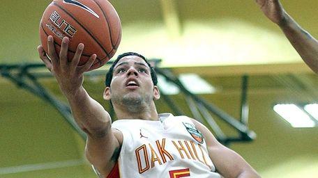 Oak Hill Academy's Cody Martin gets the basket