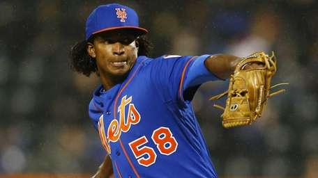Jenrry Mejia of the Mets delivers a pitch