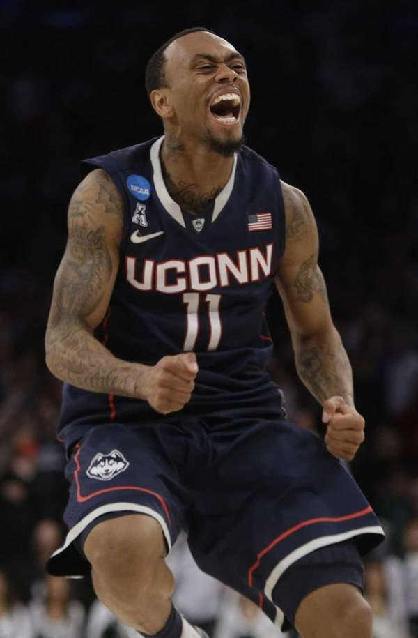 Connecticut's Ryan Boatright celebrates during the second half