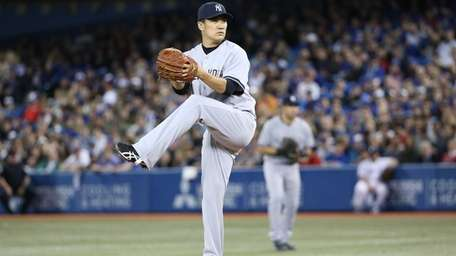 Masahiro Tanaka of the Yankees delivers the first