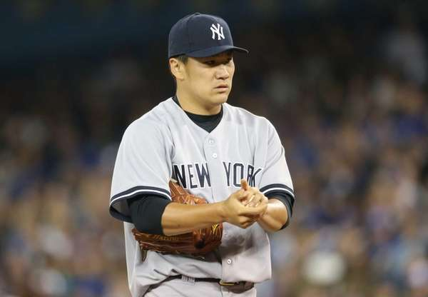 Masahiro Tanaka of the Yankees rubs up a