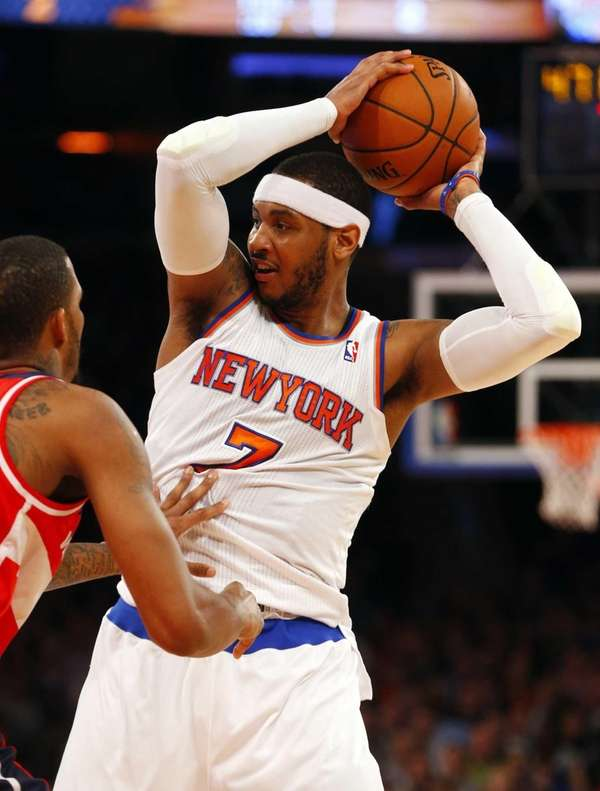 Carmelo Anthony of the Knicks controls the ball