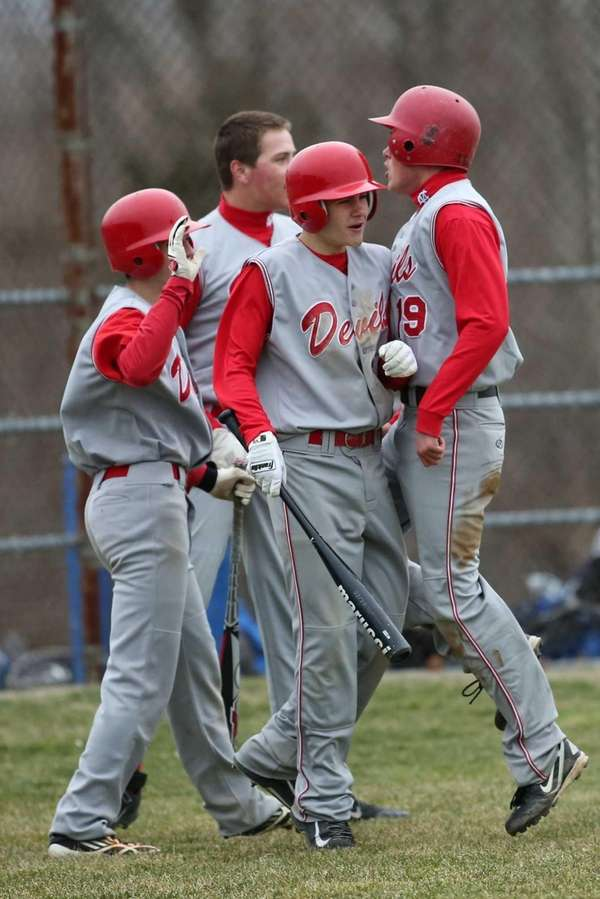Center Moriches senior Johathan Rubino celebrates his game-tying