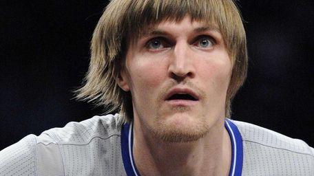 Nets forward Andrei Kirilenko looks on against the